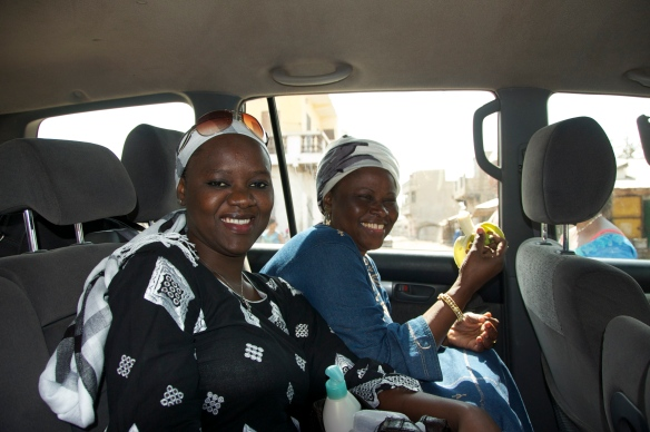 Khady & Madame Sy giggling in the car