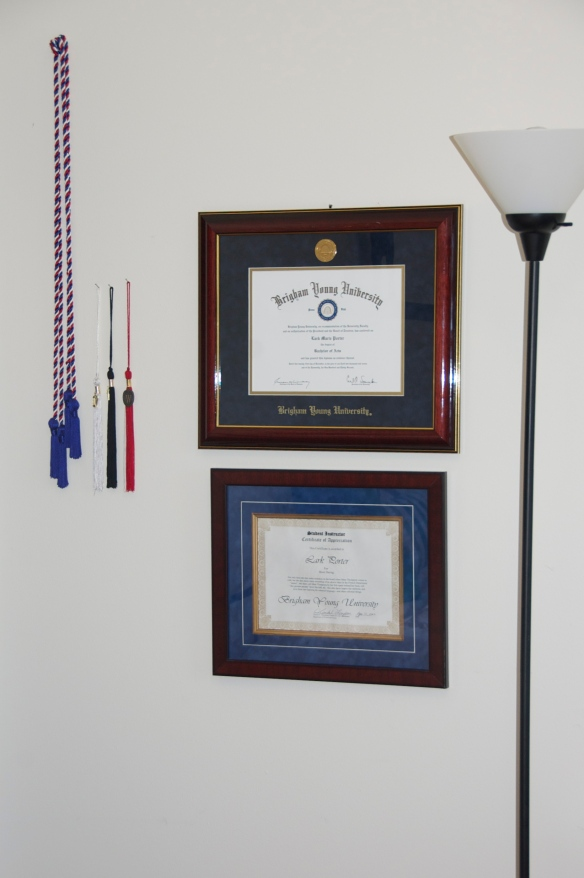 French National Honors Society cords, BYU bachelor of arts tassel (white), UW's masters degree tassel (black), and UW alumni tassel (red)