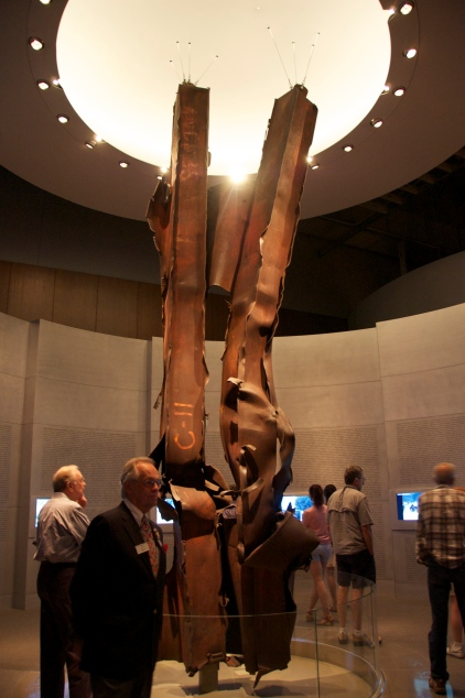 "Steel beams from Ground Zero.  Shrapnel welds them together, forming ""twin towers."""